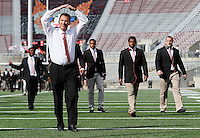 Ohio State Buckeyes head coach Urban Meyer salutes fans as the team walks on to the field before the college football game between the Ohio State Buckeyes and the Cincinnati Bearcats at Ohio Stadium in Columbus, Saturday afternoon, September 27, 2014. (The Columbus Dispatch / Eamon Queeney)