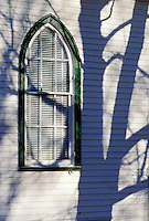 Carpenter Gothic wooden church window with moody shadow of tree #5133. Virginia, Woolen Mills Chapel.