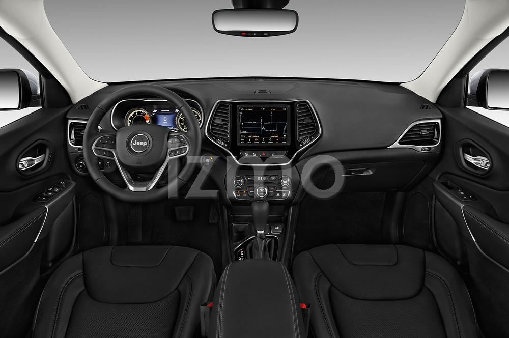 Stock photo of straight dashboard view of a 2018 Jeep Cherokee Limited 5 Door SUV