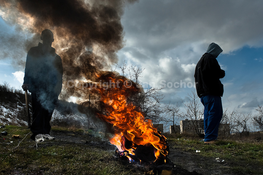 Young boys burn the used electric wires to recycle copper (and sell it afterwards) in the Gipsy ghetto of Chanov on outskirts of Most, Czech Republic, 22 March 2008.