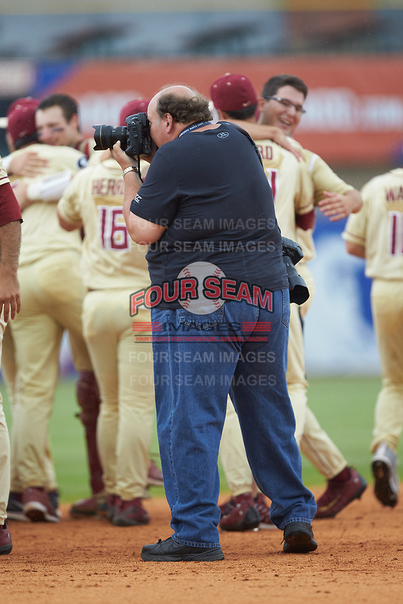 Atlantic Coast Conference contract photographer Timothy D. Easley works to get images of the Florida State Seminoles celebrating their win over the North Carolina Tar Heels in the 2017 ACC Baseball Championship Game at Louisville Slugger Field on May 28, 2017 in Louisville, Kentucky. The Seminoles defeated the Tar Heels 7-3. (Brian Westerholt/Four Seam Images)