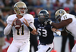 UC Davis quarterback Jimmy Laughrea looks downfield under pressure from Nevada defender Brock Hekking during the first half of a college football game in Reno, Nev., on Saturday, Sept. 7, 2013. Nevada won 36-7. (AP Photo/Cathleen Allison)
