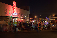 East Austin Bar District jumps with activity as the Zombie marching band parades on Halloween pub-crawl