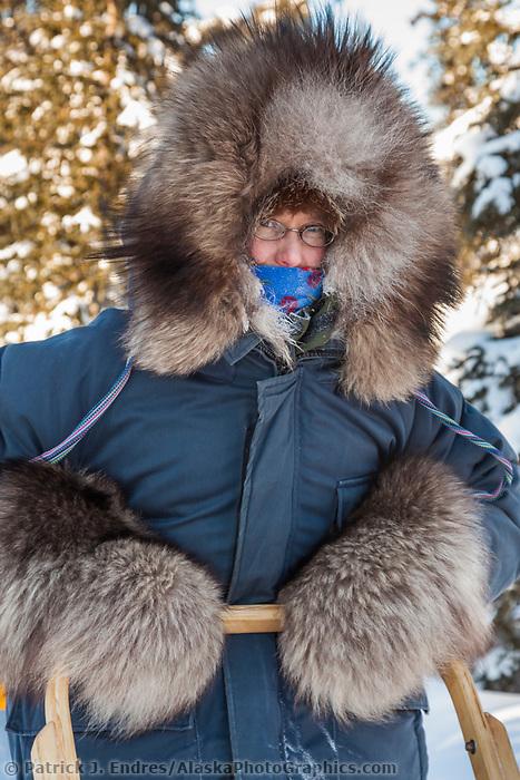 Uta Hicker wearing fur ruffed parka and fur mitts.