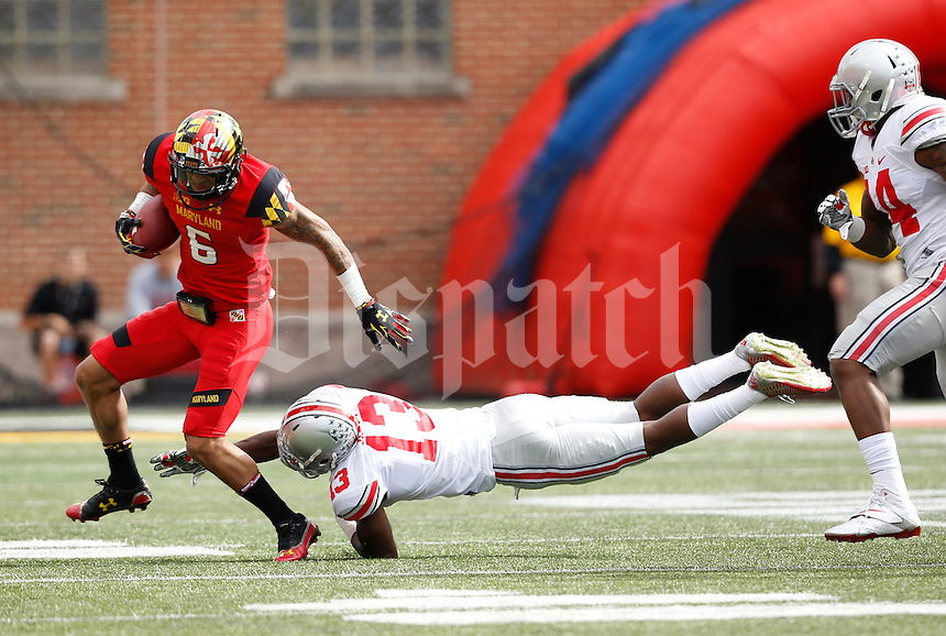 Ohio State Buckeyes cornerback Eli Apple (13) trips up Maryland Terrapins wide receiver Deon Long (6) during the third quarter of the NCAA football game at Byrd Stadium in College Park, Maryland on Oct. 4, 2014. (Adam Cairns / The Columbus Dispatch)