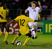 Jack McBean (19) of the United States tries to prevent Patrick Palmer (12) of Jamaica from clearing the ball out of the box during the semifinals of the CONCACAF Men's Under 17 Championship at Catherine Hall Stadium in Montego Bay, Jamaica. The United States defeated Jamaica, 2-0.