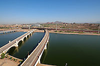 Tempe, Arizona. A northern aerial view of Tempe Town Lake showing three of its bridges: the Mill Avenue bridges (center-left) and the Light Rail bridge (left). Photo By Eduardo Barraza © 2015