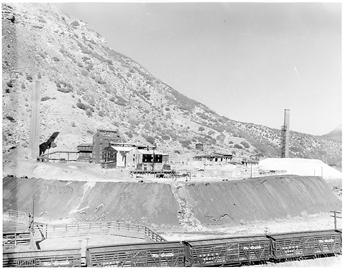Good view of Durango smelter during dismantling.  A string of D&amp;RGW stock cars is positioned at the stock yards.<br /> D&amp;RGW  Durango, CO
