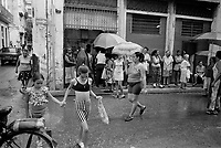 Habaneros wait in a rainy line collect goods from an official ration store in Havana, Cuba, January, 1999.  Facing difficulties from the loss of Soviet support, Cuba opened an unofficial dollar economy in the late 1990s.