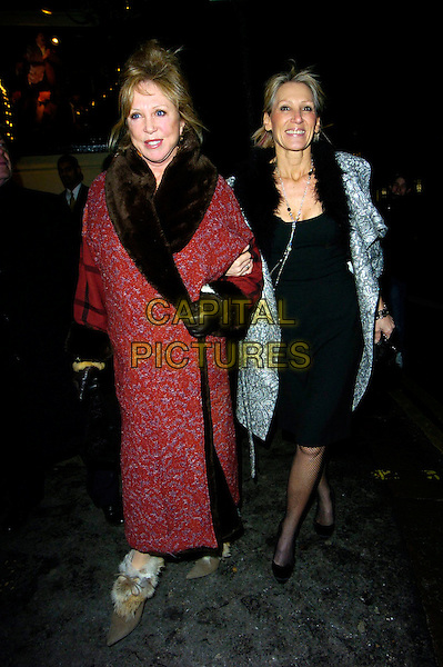 "PATTIE BOYD & INGRID TARRANT.""Guys & Dolls"" VIP Performance, Picadilly Theatre, London, UK..January 24th, 2007.full length grey gray pattern coat black dress necklace fur trim red brown arms linked Patty.CAP/CAN.©Can Nguyen/Capital Pictures"
