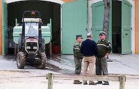 Jean-Pierre Rambier with inspectors. Tractor delivering grapes to the winery. Domaine Haut-Lirou in St Jean de Cuculles. Pic St Loup. Languedoc. The winery building. France. Europe.