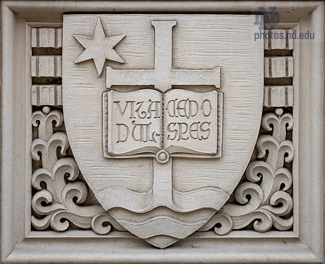 """March 30, 2020; Relief of the University seal over a door to O'Shaughnessy Hall. Latin """"Vita Dulcedo Spes"""" translates to """"Life, Sweetness, Hope."""" (Photo by Matt Cashore/University of Notre Dame)"""