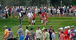 Cromwell, CT-25 JUNE 25 2017-062517MK16 Jordan Spieth and Boo Weekley chat as they walk down the sixth fairway surrounded by thousands of golf fans  at the final round of the 2017 Travelers Championship at the TPC River Highlands in Cromwell. Michael Kabelka / Republican-American