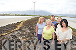 DESTROYED: An extensive fire on the sand dunes connecting Fenit to Fenit island on Thursday left extensive damed to the beauty stop. From front l-r were: Bridie Brassil, Mary O'Brien and Fiona Ladden. Back l-r were: Maire Vieux and Mike O'Neill.