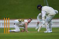 Jimmy Neesham fields of his own bowling on day one of the Plunket Shield cricket match between the Wellington Firebirds and Otago Volts at Basin Reserve in Wellington, New Zealand on Monday, 21 October 2019. Photo: Dave Lintott / lintottphoto.co.nz