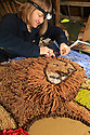 28/05/14 <br /> <br /> Wendy Greatorex (46) has been designing the Hand's Well well-dressings for 27 years. She began helping to make them when she was two-years-old.  This year, her design is called 'The Lion and the Lamb'.<br /> <br /> Wooden boards coated in clay are decorated with tens of thousands of petals, leaves and pieces of foliage to create giant intricate mosaics. The boards, that each take teams of ten villages three days to make are part of the Well Dressing displays in Tissington, Derbyshire. <br /> <br /> The village has been decorating its six wells every year for more than six hundred years. The tradition is believed to be a celebration of the wells never running dry, giving life and  sustaining the village during times of plague. After a church service today (Thursday)  clergy from six parish will bless each of the well.  <br /> <br /> Following in Tissington's footsteps many other villages in the Derbyshire area also have their own well dressing traditions.<br /> All Rights Reserved - F Stop Press.  www.fstoppress.com. Tel: +44 (0)1335 300098
