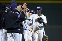Luis Robert (21) of the Winston-Salem Dash high fives his teammates following their win over the Wilmington Blue Rocks at BB&T Ballpark on April 15, 2019 in Winston-Salem, North Carolina. The Dash defeated the Blue Rocks 9-8. (Brian Westerholt/Four Seam Images)