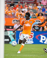 Houston Dynamo forward Kei Kamara (10) strikes the ball for a goal in the 21st minute.  Houston Dynamo defeated Chicago Fire 3-2  at Robertson Stadium in Houston, TX on August 9, 2009.