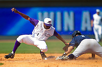 Kyle Davis #1 of the Winston-Salem Dash applies a late tag as Nicholas Francis #7 of the Wilmington Blue Rocks steals second base at BB&T Ballpark on April 24, 2011 in Winston-Salem, North Carolina.   Photo by Brian Westerholt / Four Seam Images