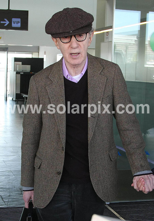 **ALL-ROUND PICTURES FROM SOLARPIX.COM**.**WORLD SYNDICATION RIGHTS EXCEPT BELGIUM, GERMANY, HOLLAND, SCANDINAVIA, SOUTH AMERICA, SPAIN, & USA**.Actor and comedian Woody Allen arrives in Barcelona, Spain on Monday, accompanied by wife Soon-Yi Previn for his concert in the Catalan capital...This pic: Woody Allen & Soon-Yi Previn..JOB REF: 10994     SKX      DATE:  28.03.2010.**MUST CREDIT SOLARPIX.COM OR DOUBLE FEE WILL BE CHARGED**.**MUST NOTIFY SOLARPIX OF ONLINE USAGE**.**CALL US ON: +34 952 811 768 or LOW RATE FROM UK 0844 617 7637**