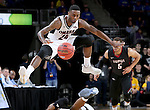 SIOUX FALLS, SD: MARCH 6: Tra-Deon Hollins #24 from Omaha leaps over a teammate to get the ball against IUPUI during the Summit League Basketball Championship on March 6, 2017 at the Denny Sanford Premier Center in Sioux Falls, SD. (Photo by Dave Eggen/Inertia)