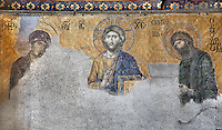 Detail of Deesis mosaic, 12th-13th century, showing Virgin Mary, Jesus Christ, and John the Baptist, Hagia Sophia, 532-37, by Isidore of Miletus and Anthemius of Tralles, Istanbul, Turkey. Hagia Sophia, The Church of the Holy Wisdom, has been a  Byzantine church and an Ottoman mosque and is now a museum. The current building, the third on the site, commissioned by Emperor Justinian I, is a very fine example of Byzantine architecture. The historical areas of the city were declared a UNESCO World Heritage Site in 1985. Picture by Manuel Cohen.