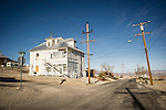 White house and street with power poles and lines, Tonopah, Nev.