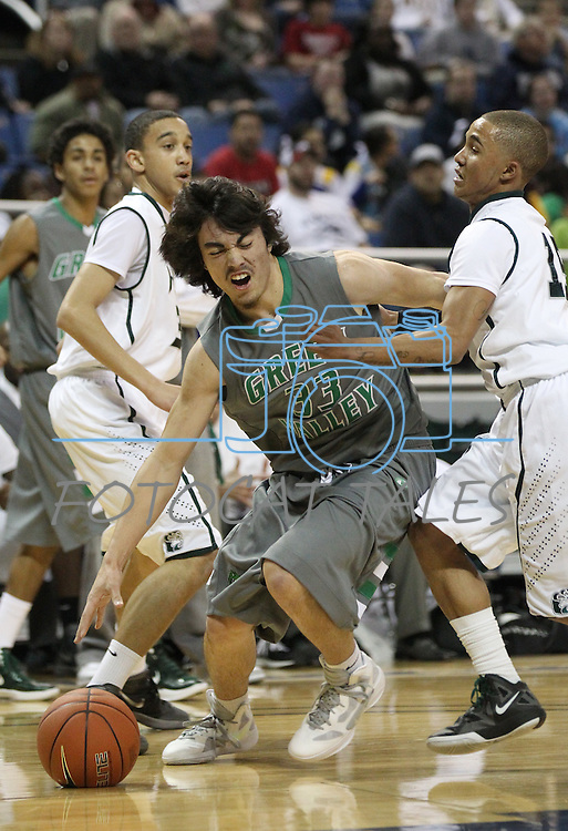 Green Valley's Ikaika Pladera tries to get past Hugh defenders during a semi-final game in the NIAA 4A State Basketball Championships between Hug and Green Valley high schools at Lawlor Events Center in Reno, Nev, on Thursday, Feb. 23, 2012. .Photo by Cathleen Allison