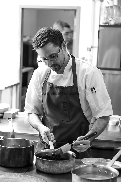 Chef Justin Woodward in the kitchen at Castagna Restaurant in Portland, OR, a clean-lined, minimalist restaurant serving fixed-price, high-end modernist Northwest dinners.