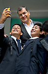 President Correa poses for selfies with students on visit to his childhood school in Guayaquil