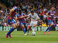 Pictured: Jason Puncheon of Crystal Palace (2nd L) challenges Jack Cork of Swansea<br />