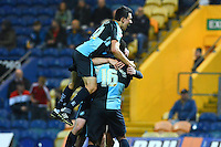 Wycombe Wanderers Luke O'Nien jumps on Aaron Amadi-Holloway after the substitute sealed the victory with their second goal during the Sky Bet League 2 match between Mansfield Town and Wycombe Wanderers at the One Call Stadium, Mansfield, England on 31 October 2015. Photo by Garry Griffiths.