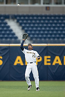 Michigan Wolverines outfielder Johnny Slater (25) makes a catch in the outfield against the Michigan State Spartans on May 19, 2017 at Ray Fisher Stadium in Ann Arbor, Michigan. Michigan defeated Michigan State 11-6. (Andrew Woolley/Four Seam Images)