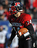 Plainedge quarterback No. 14 Davien Kuinlan rushes for a gain during the Nassau County varsity football Conference III final against Glen Cove at Hofstra University on Saturday, Nov. 21, 2015. He ran for a record-breaking 484 yards and seven touchdowns in Plainedge's 56-34 win.<br /> <br /> James Escher