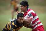 Left wing for Karaka Tenna Sauileoge runs in to the Ahki Pulu tackle. Counties Manukau Premier Club Rugby game between Bombay and Karaka, played at Bombay, on Saturday March 15 2014. Karaka won the game 39 - 12 after leading 13 - 5 at halftime.  Photo by Richard Spranger