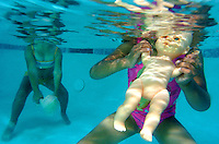 V.pool.11.0421.jl.jpg/photo Jamie Scott Lytle/Toys are avalable to the kids to play with and Tatiana Floriano, right and Savanna Ramos of Mission Meadows gravitate to the  baby dolls  in the Mary Lou Clack therapy pool in Vista. Jamie Scott Lytle Photography
