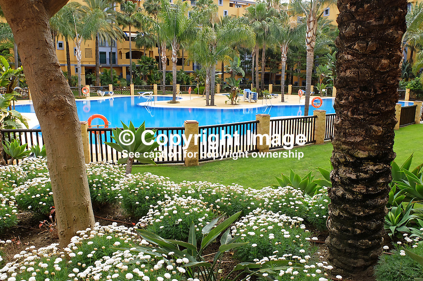 Swimming pool, apartments, Los Jazmines, San Pedro de Alcantara, Marbella, Spain, Espana, April, 2016, 201604192451<br /> <br /> Copyright Image from Victor Patterson, 54 Dorchester Park, Belfast, UK, BT9 6RJ<br /> <br /> t1: +44 28 9066 1296 (from Rep of Ireland 048 9066 1296)<br /> t2: +44 28 9002 2446 (from Rep of Ireland 048 9002 2446)<br /> m: +44 7802 353836<br /> <br /> e1: victorpatterson@me.com<br /> e2: victorpatterson@gmail.com<br /> <br /> The use of my copyright images is subject to my Terms & Conditions.<br /> <br /> It is IMPORTANT that you familiarise yourself with them. They are available on my website at www.victorpatterson.com.<br /> <br /> None of my copyright images may be used on a website unless they are visibly watermarked, i.e. © Victor Patterson within the body of the visible image. Metadata denoting my copyright must NOT be deleted. <br /> <br /> Web use is extra at currently recommended NUJ rates.