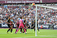 Issa Diop of West Ham United heads over  during West Ham United vs Manchester City, Premier League Football at The London Stadium on 10th August 2019
