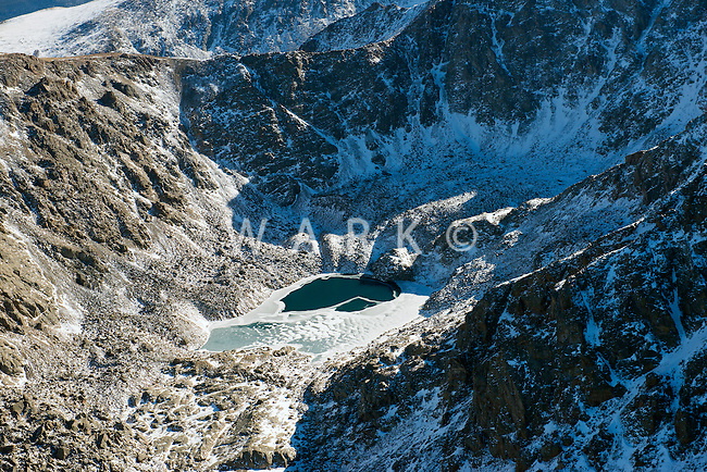 Rocky Mountains, Collegiate Range in Colorado.  Little frozen lake.  Nov 2012