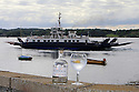 TRAVEL PIECE TO GO WITH GLENN PATTERSON COUNTY DOWN -  A bottle of Short Cross Gin with the Portaferry Strangford ferry.   Photo/Paul McErlane