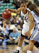 The Tournament MVP, Jasmine Thomas, doesn't let UNC's Cetera DeGraffenreid from stop her from scoring 21 total points.This was the Championship game of the 2011 ACC Tournament in Greebsboro on March 6, 2011. Duke beat UNC 81-66. (Photo by Al Drago).