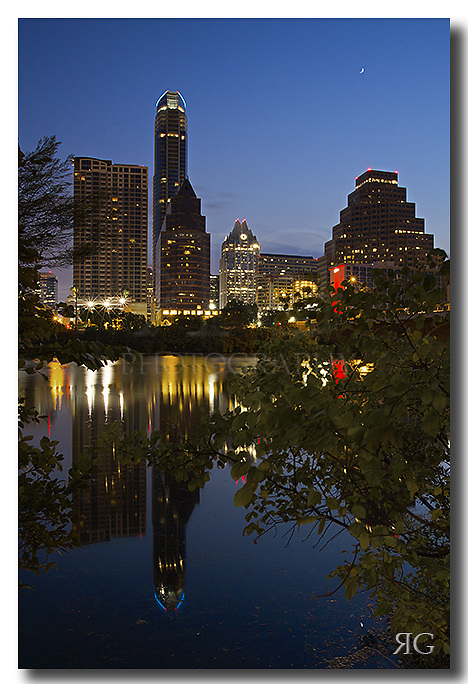 The Austonian, Austin's tallest building, rises into the early morning hours of a September sunrise. This Austin image was taken about 45 minutes before the sun rose over the horizon. Ladybird Lake was quiet and the waters were calm. <br />