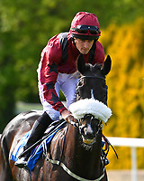 Magic Beans ridden by Charlie Bennett goes down to the start of The Smith & Williamson Handicap (Class 6)     during Afternoon Racing at Salisbury Racecourse on 17th May 2018