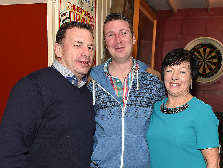 Gary O'Rourke celebrating his 30th birthday in The Windmill bar with godparents John and Linda O'Rourke. Photo:Colin Bell/pressphotos.ie