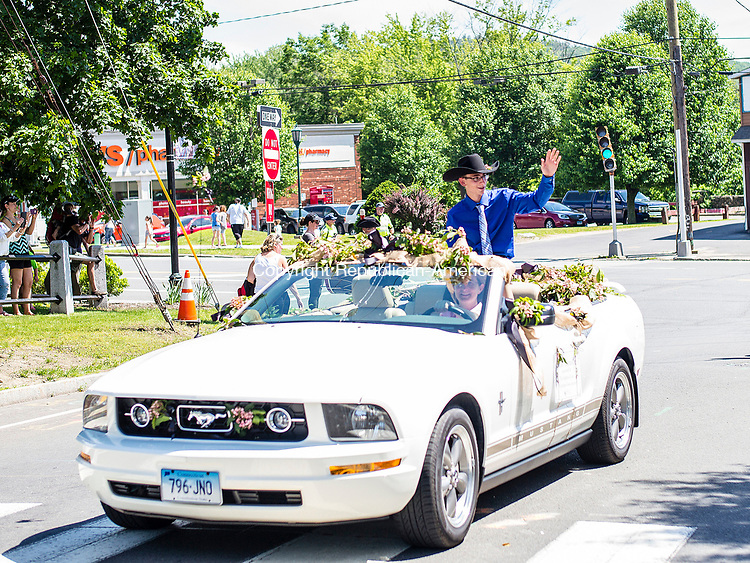 Winsted, CT- 11 June 2017-061117CM02-  Dylan Thomson waves to the crowd during the annual Laurel Festival Parade in Winsted on Sunday. Thomason was named the 2017 Laurel Festival King.   Christopher Massa Republican-American