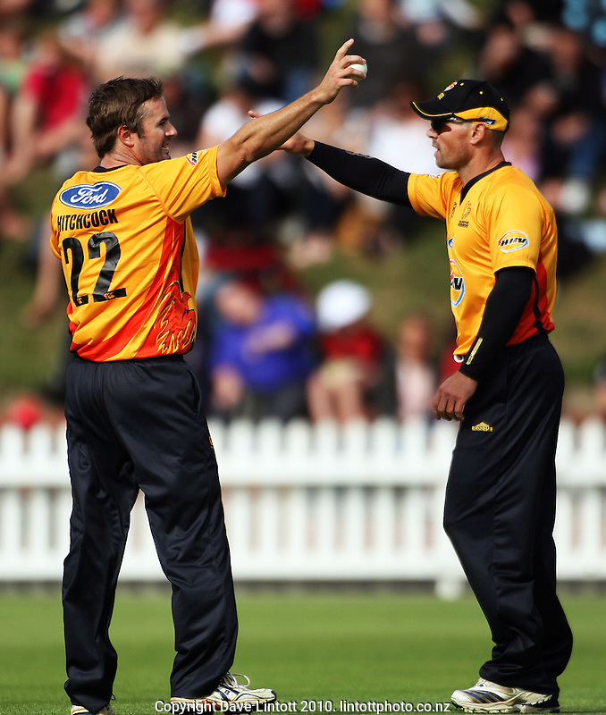 Wellington bowler Paul Hitchcock and captain Matthew bell discuss fielding options during the HRV Cup Twenty20 cricket match between the Wellington Firebirds and Canterbury Wizards at Allied Nationwide Finance Basin Reserve, Wellington, New Zealand on Wednesday, 6 January 2010. Photo: Dave Lintott / lintottphoto.co.nz