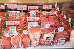 Meat display in butcher's shop window