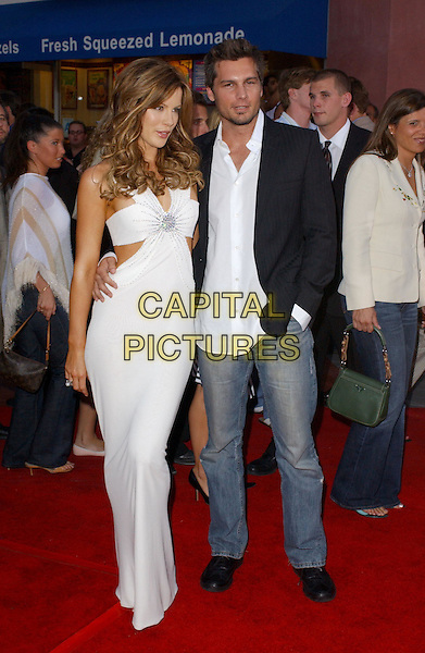 KATE BECKINSALE & LEN WISEMAN.Attending the world premiere of movie Van Helsing at The Universal City Walk in Universal City, California..May 3rd 2004.full length full-length boyfriend white dress plunging neckline cleavage cut out silver strappy heels shoes big curly hair highlights smiling.*UK sales only*.www.capitalpictures.com.sales@capitalpictures.com.©Capital Pictures