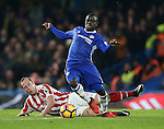 Chelsea's N'Golo Kante tussles with Stoke's Charlie Adam during the Premier League match at Stamford Bridge Stadium, London. Picture date December 31st, 2016 Pic David Klein/Sportimage