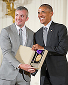 United States President Barack Obama presents the 2015 National Medal of Arts to the Eugene O'Neill Theater Center of Waterford, Connecticut, during a ceremony in the East Room of the White House in Washington, DC on Thursday, September 22, 2016.<br /> Credit: Ron Sachs / CNP